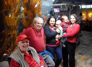 Here I am with most of my family at the Aquarium. By magic, I carried my nephew for a long time!