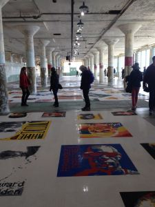 Ai Weiwei's exhibit at Alcatraz, @Large. The floor is covered with portraits of political prisoners crafted with Legos.