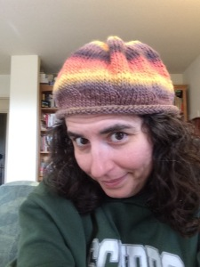 "When everything else feels wrong. I knit something pretty. This time, I made a hat for myself. I did it without a pattern, and ran out of yarn, so it is my ""acceptance of how things are in life"" hat."